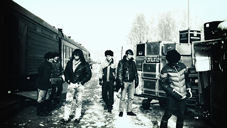 The band unloads their equipment from the train in Mongolia